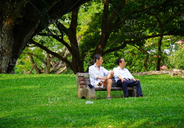 2 Elderly Men Sitting On A Park Bench Stock Photo E1839297 0616 45e6