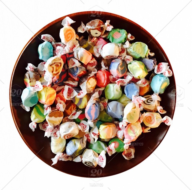 stock-photo-white-background-colorful-traditional-candy-sweets-lay-flat-saltwater-taffy-64aa3144-7b68-4d5a-a9b3-b10331c84760.jpg