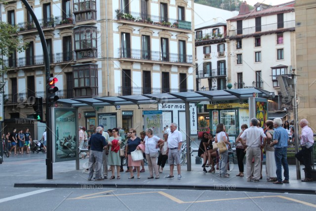 People waiting at a bus stop in San Sebastian, Spain. stock photo  556f4b54-8015-4dff-9e01-3c44bb901e4f