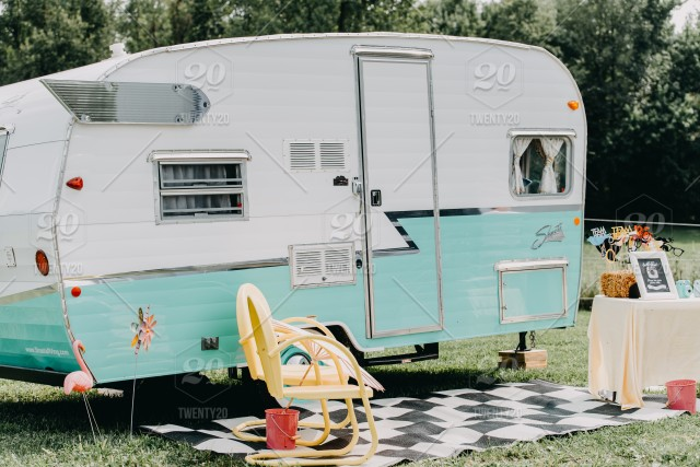 Vintage Camper Used As A Prop For A Wedding Reception Photo Booth