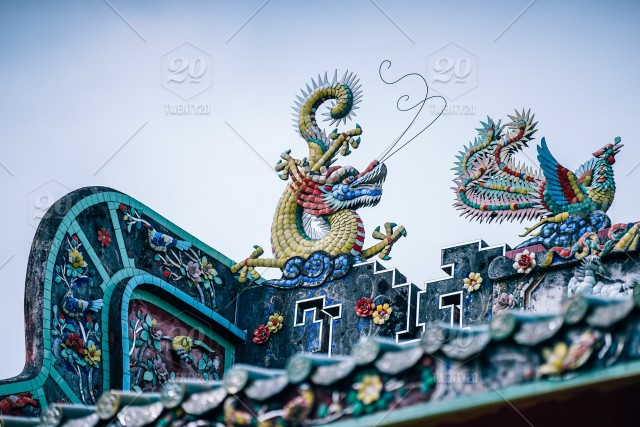 Red and golden Dragon statue with bluebird statue on the rooftop of