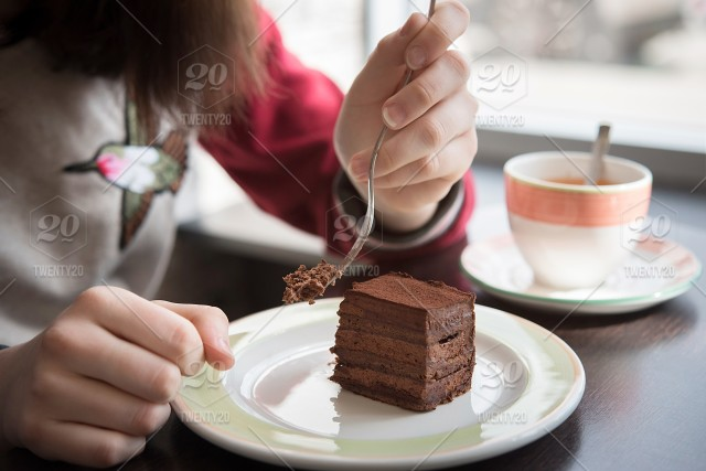 Young Girl Eating Chocolate Cake In The Cafe Coffee Woman Girl