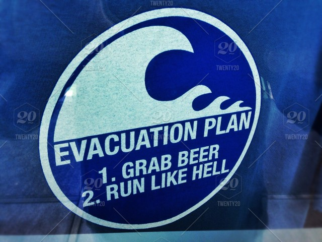Parody sign of tsunami warning and evacuation signs stock photo