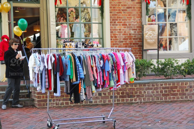 Shopping time  Display of children's clothing store in the street