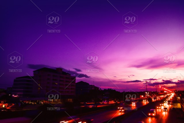 Light cars driving on road on evening and sunset sky beauty day to