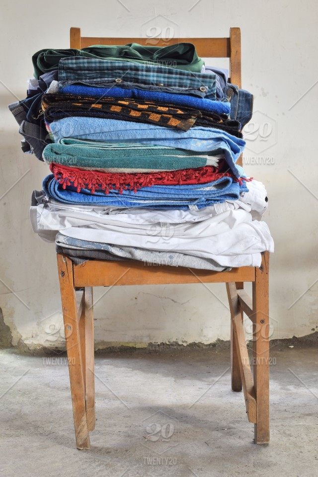 Folded laundry on the chair stock photo 77a15c4d-4faa-4977 ...