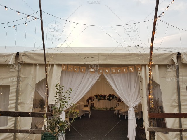 Just Married Sign Above An Entrance Into A Wedding Tent Wedding