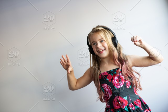 e6e8b5fc7 Natural light portrait of beautiful girl listening music in ...