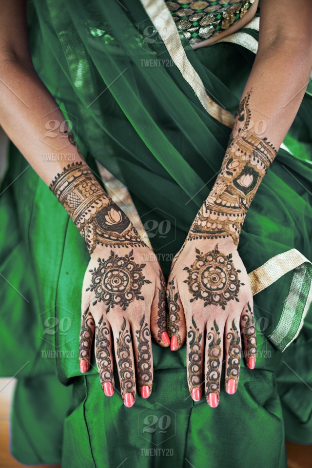 Close Up Shot Of Indian Bride Back Hand With Mehndi Henna Tattoo