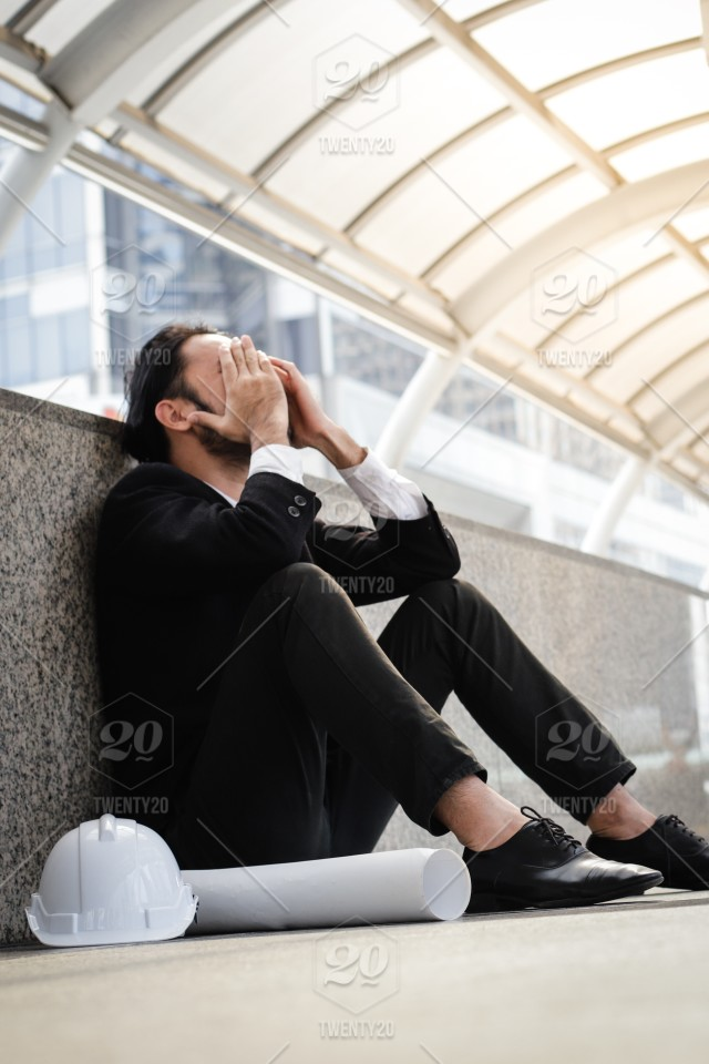 Serious and depressed tired asian engineering businessman tired from
