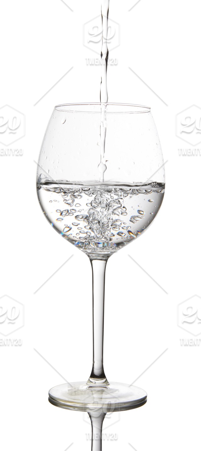 Water Pouring Into Clear Wine Glass On White Background