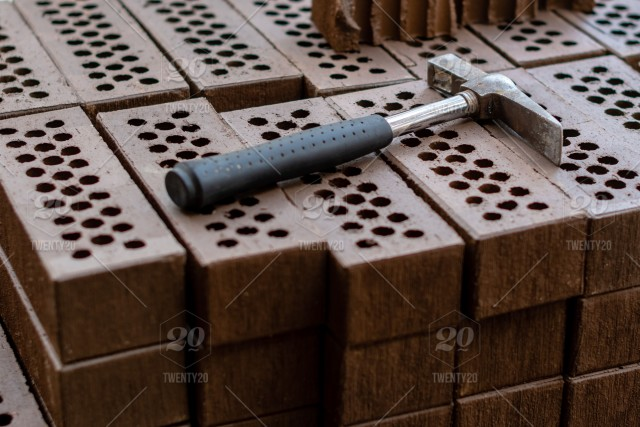 A Hammer Is Laid On A Red Brick Stack Abstract Aged Architecture