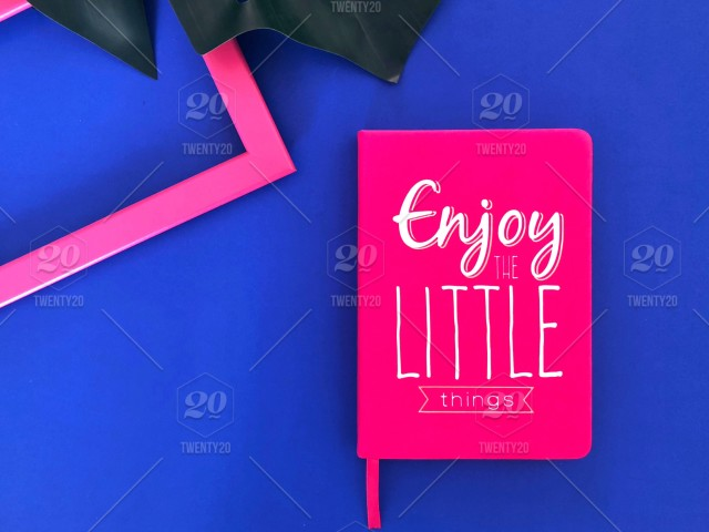 flat lay enjoy the little things bright hot pink notebook empty