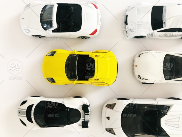 Yellow Toy Car Among White Toy Cars Top View Concept Conceptual