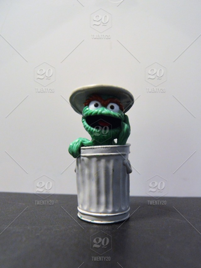 Sesame Street Character Oscar The Grouch In His Trash Can