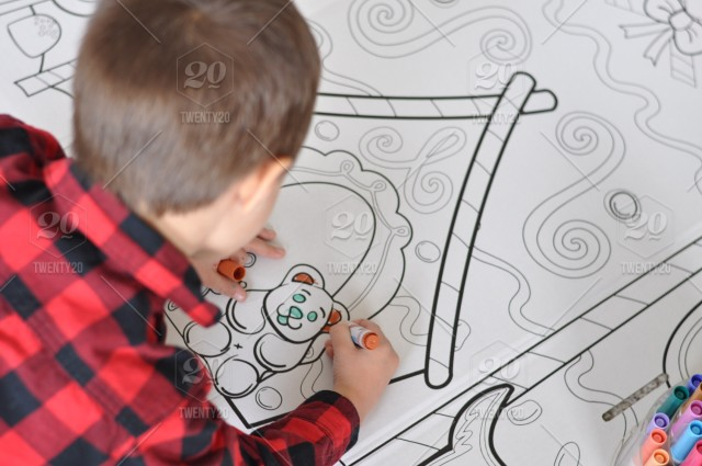 Little boy coloring with markers stock photo 44c7a2ee-8744 ...