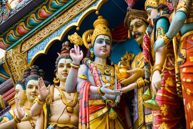 Colorful statues of Hindu gods on the exterior of the Sri
