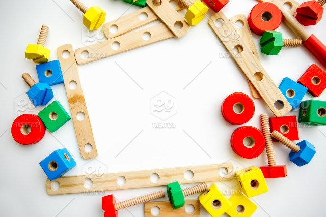 Closeup of toy wooden bricks and sticks on white table