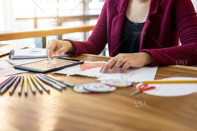 Close Up Of Woman Fashion Designer At Work Drawing Sketches For Clothes In Atelier With Tailor Tool And Color Charts Profession And Job Occupation Fashion Designer Stylish Concept Stock Photo 6cef1600 46d0 400e B229 2a21fd5f0052
