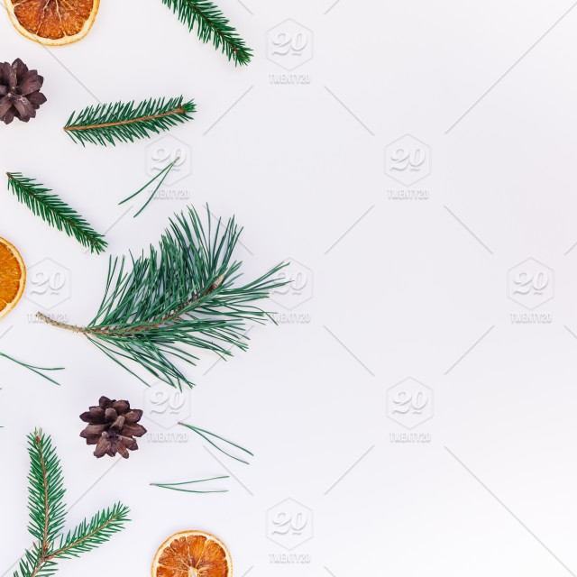 new year christmas pattern flat lay top view xmas holiday handmade handicraft texture with fir tree pine branches cones dried oranges white background copy