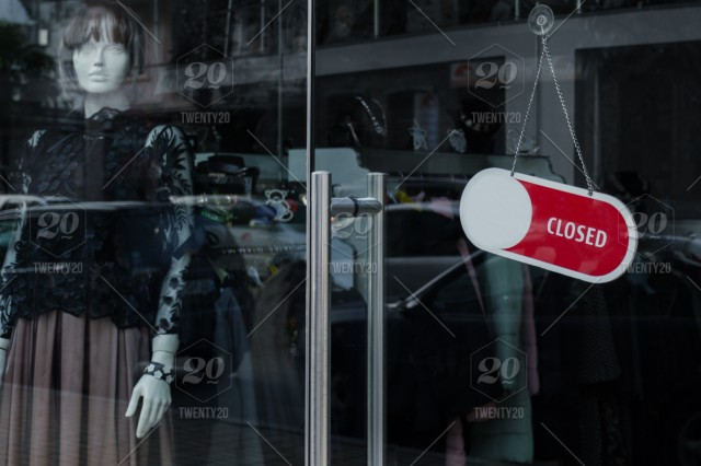 da10f6dae81 Glass door of a clothing store with a «Closed