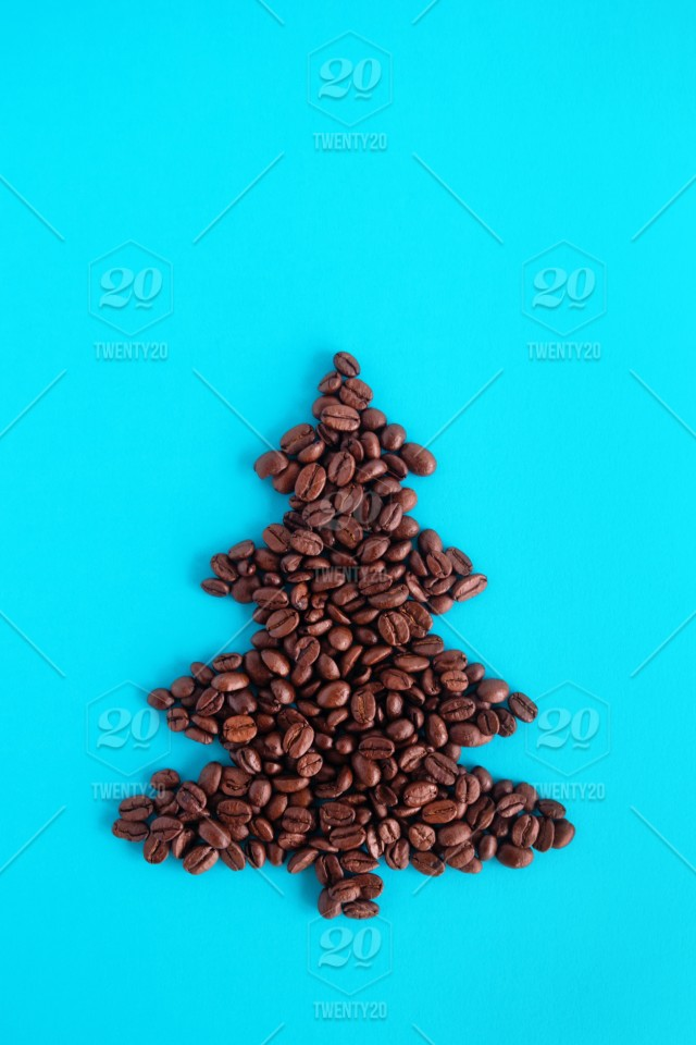 Christmas Tree Top View.Christmas Tree Made From Coffee Beans On A Blue Background