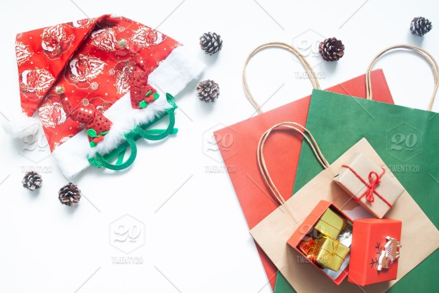 creative flat lay happy new year gift box and shopping bag on white background