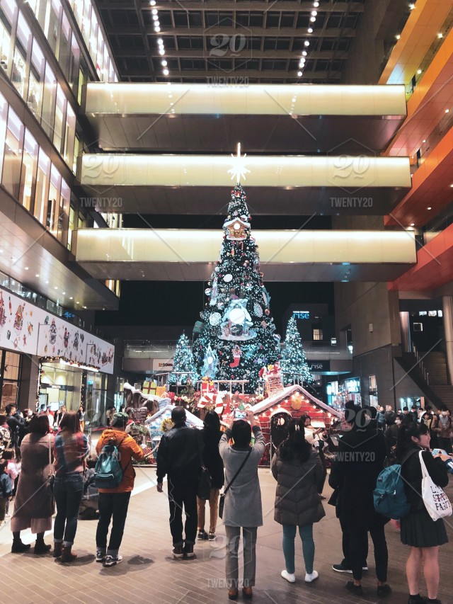 Japanese Christmas Tree.Crowds In Front Of A Christmas Tree At A Japanese Shopping Mall