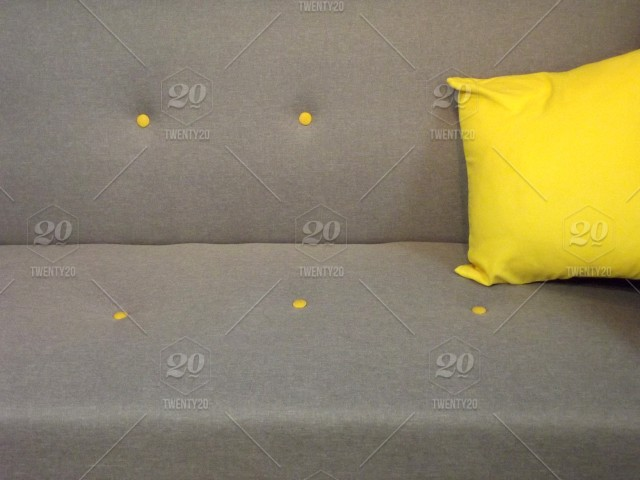 Home Decor Grey Sofa With A Square Yellow Cushion Stock Photo