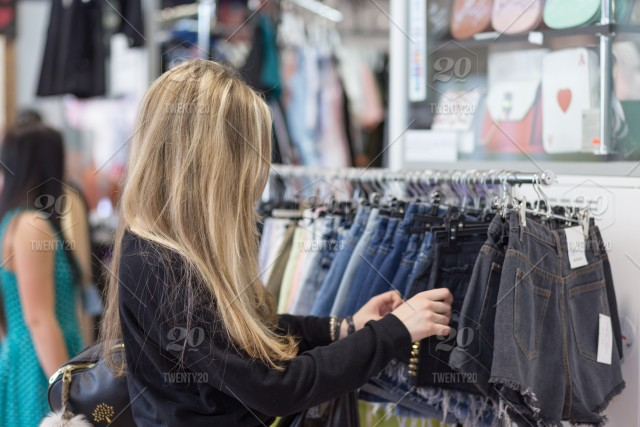 7131cc8f33 NOMINATED! A girl chooses clothes in a store, young, happy, store ...