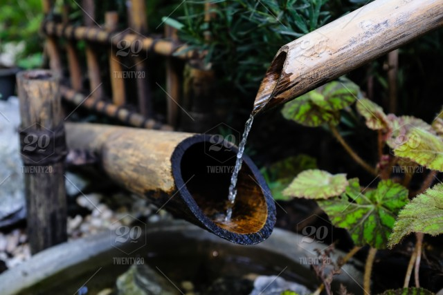 Japanese Bamboo Water Fountain Shishi Odoshi In A Zen Garden Stock Photo  D65f789c D7d9 44f5 A4b9 0c9a5bee8041