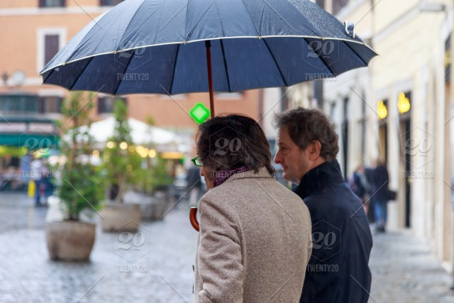 4a9eb385d Two elderly Italian men under umbrellas in rainy weather in Rome, people,  old, adult, weather, elderly, lifestyle, senior, city, person, couple,  street, ...