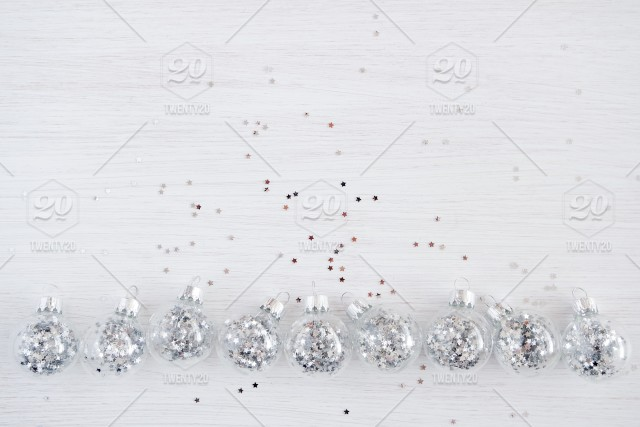 White Christmas Snow Background.Christmas Balls Silver Stars Shine Winter Snow White