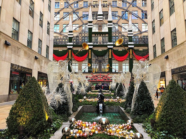 Christmastime in New York City! Festive christmas ornaments beautifully surround Rockefeller Center as the iconic Saks Fifth Avenue is impeccably decorated ...