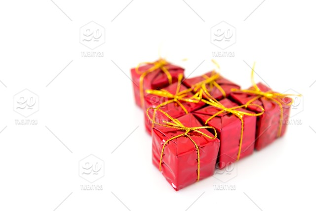Christmas red shiny gift boxes isolated on a white background with