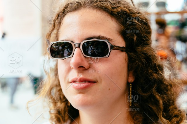 21bcbd191 Pretty hipster girl in sunglasses with red curly hair. Close-up lifestyle  outdoor urban portrait. America; Manhattan; NYC; New York; New York City;  USA; ...