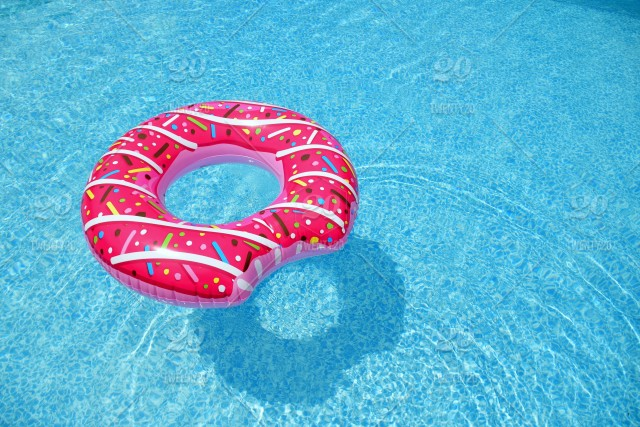 Simple, minimal summertime fun is a pink doughnut pool float ...