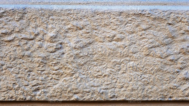 Close Up Photo Fragment Of Masonry Wall With Decorative Plaster