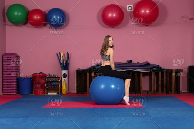 b2e98b734 Woman on a fitness ball in a gym. active, athletic, attractive, background,  ball, beautiful, body, care, caucasian, clothes, colorful, exercise,  exercising, ...