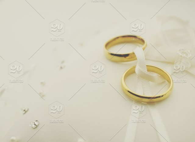 Matte Wedding Background With Gild Rings On Ring Pillow Stock Photo