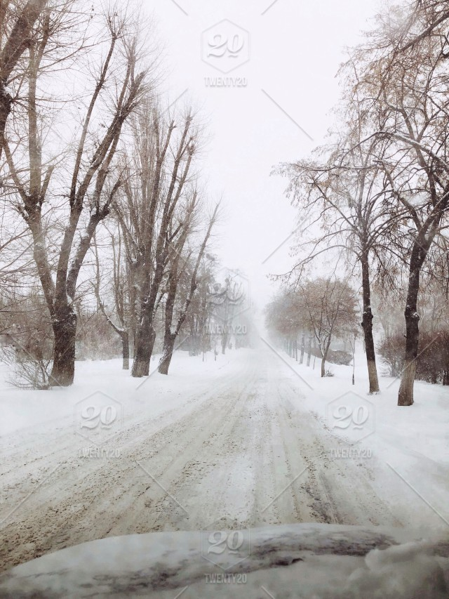 Long way home  Driving to nowhere  Snowy winter in the car  Baby, it