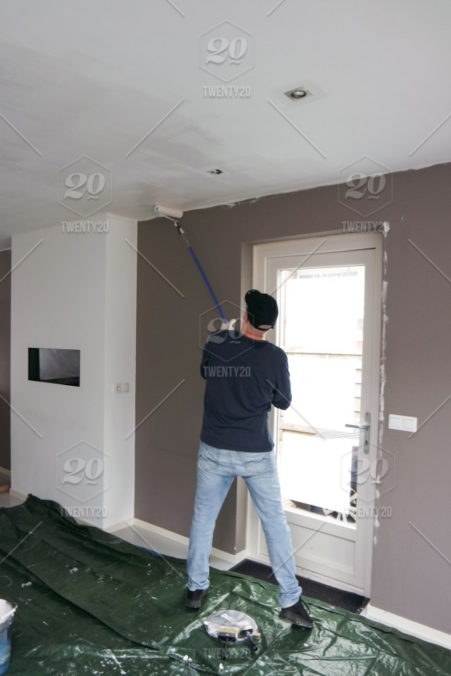 Full length of a man painting the ceiling  New home  Home renovation