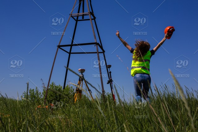 Professional Female Land Surveyor Measures Ground Control Point