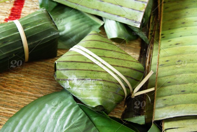 Vietnamese Traditional Cake For Celebrating New Year From Rice Meat And Species Wrapped In Banana Leaves Tet Cake Stock Photo 596f5d26 9884 4702 B08f Fec4a7131069