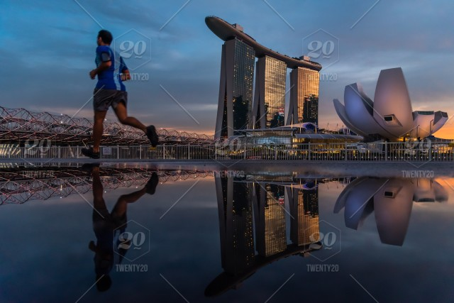 Exercise With A View A Man Jogging By The Iconic Marina Bay Sands
