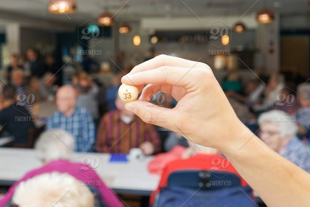 Playing bingo, in a home, with old people , nm 33, a bingobal in a