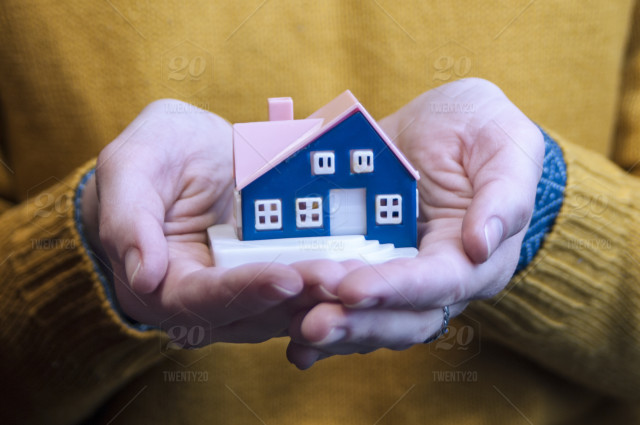 f3244859c5 Girl holding house in hands