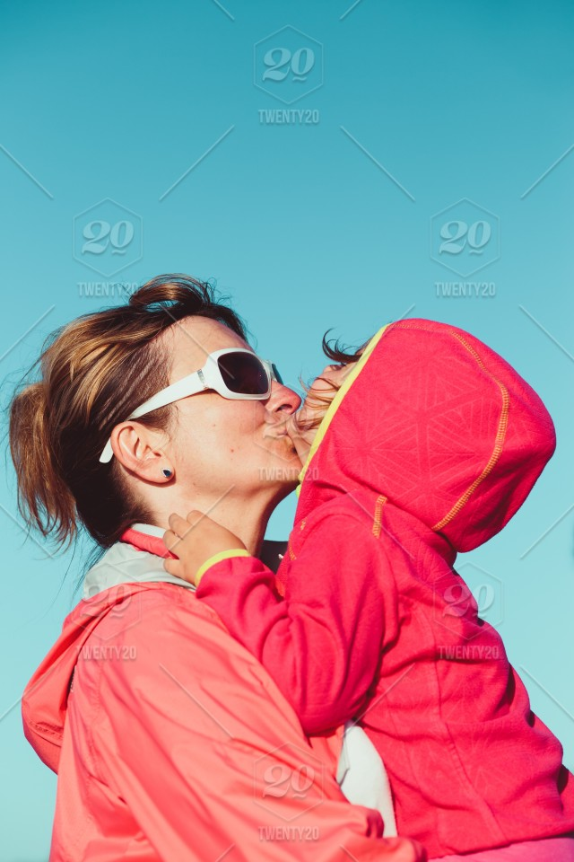 3576f58c1c34a Love of mother and daughter. Mother hugging with her little daughter  outdoors. Having fun, enjoying summer vacations stock photo  9f493e26-1b42-4b24-9c9f- ...