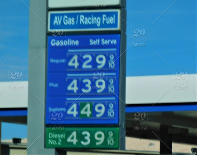 Gas and Oil! Gas prices on a gas station advertising sign  Depending
