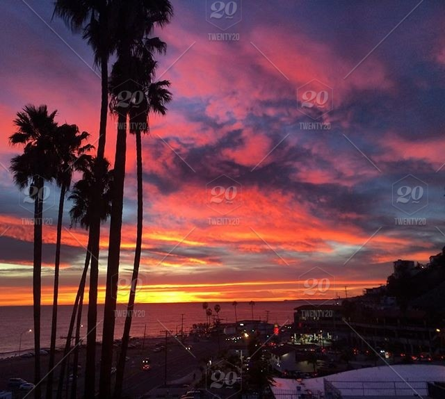 View of the sunset resting on PCH stock photo 0c158ac2-6dbe-4c07